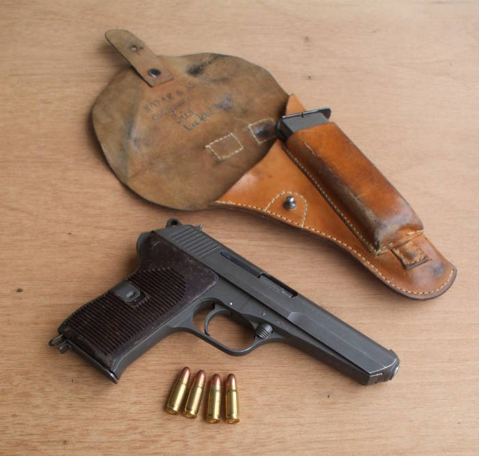 CZ-52 or ČZ vzor 52 pistol 					with holster and 7.62x25mm ammunition.
