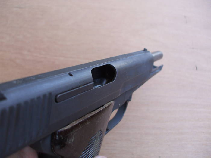 Lock the CZ-52 slide back and verify that the chamber is empty and the weapon is unloaded.