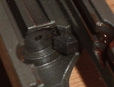 Correctly assembled firing pin and slide.  The tip of the firing pin is well below the surface of the bolt face.